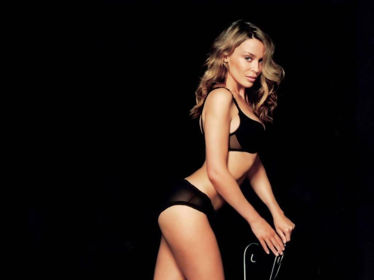 kylie-minogue-posing-on-the-chair-wallpaper-945569654