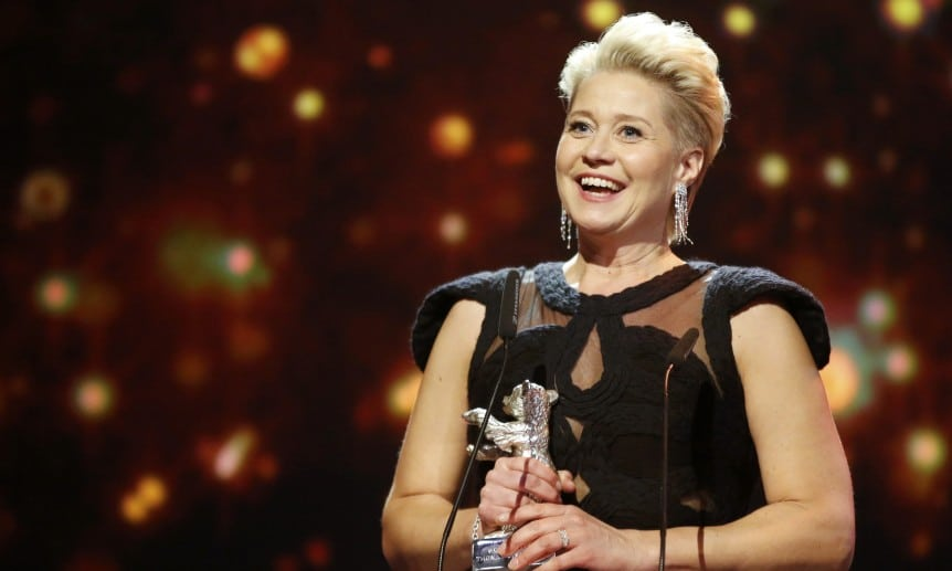 Actress Dyrholm holds the Silver Bear award for the best actress in the film 'The Commune' during the awards ceremony of the 66th Berlinale International Film Festival in Berlin